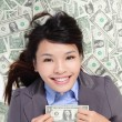 Business woman excited lying on money bed — Stock Photo