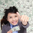 Business woman show thumb up with money — Stock Photo