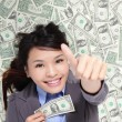Business woman show thumb up with money — Stock Photo #18945109