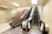 The escalator moving at metro station — Stockfoto