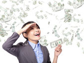 Business woman happy with money rain — Stock Photo