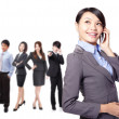 Young pretty asian woman on the phone with team — Stock Photo