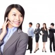 smiling call center executive with colleagues — Stock Photo