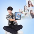Young man using social networking with friends — Stock Photo