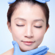 Royalty-Free Stock Photo: Plastic surgery touching woman face