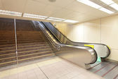 The escalator moving at a metro railway station — Stok fotoğraf