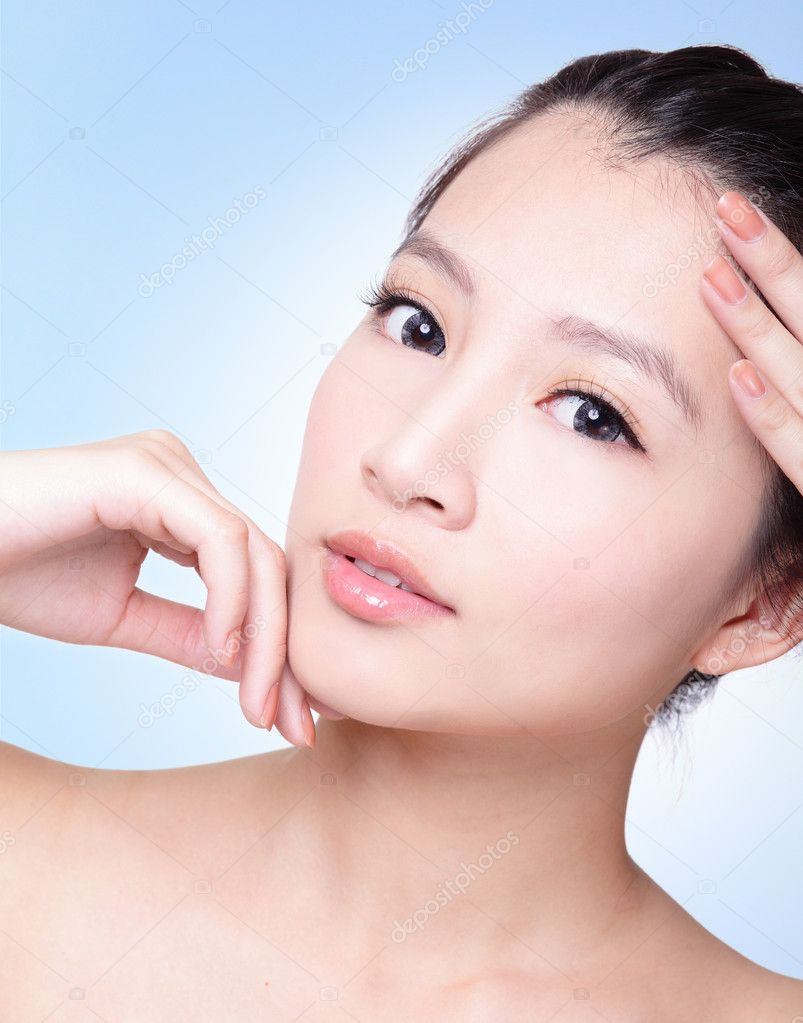 Natural health beauty of a woman face, she finger touch her perfect skin with blue background, asian beauty model — Stock Photo #19266557