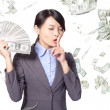 Woman finger on lips asking quiet with money — Stock Photo