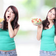 Healthy lovely woman with salad - Stockfoto