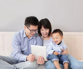 Happy family using tablet pc — Stock Photo