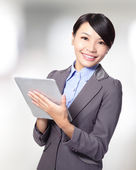 Business woman holding a tablet pc — Stock Photo