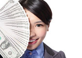 Half face of a business woman and money — Stock Photo