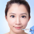 Royalty-Free Stock Photo: Woman gets Cosmetic injection in lips