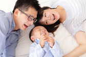 Happy family with children in bed — Stock Photo