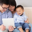 Happy family using tablet pc — Stock Photo #20662117