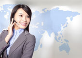 Business woman operator with asia map — Stock Photo