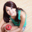 Royalty-Free Stock Photo: Young happy smiling woman with apple