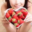 Royalty-Free Stock Photo: Woman smiling with strawberry
