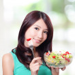 Royalty-Free Stock Photo: Attractive woman smile eating salad