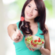 Attractive woman smile eating salad — Stock Photo