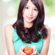 Asian woman holding fruit tomato — Stock Photo