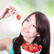 Woman smiling with fruit strawberry — Stock Photo
