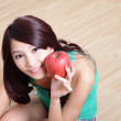 Young happy smiling woman with apple — Stock Photo