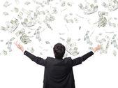 Uomo d'affari abbraccio soldi — Foto Stock