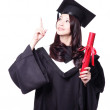 Royalty-Free Stock Photo: Graduating student finger pointing to copy space