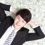 Happy businessman lying — Stock Photo