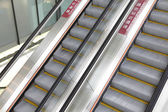 Moving escalator in airport — Foto Stock