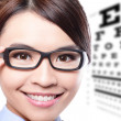 Stok fotoğraf: Womwith glasses and eye test chart