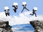 Businessman jumping with billboard on the mountain — Stock Photo