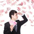 Happy business man hold China money — Stock Photo