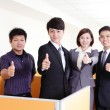Business group smiles and showing thumb up — Stock Photo #29202837
