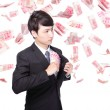 Happy business man hold China money — Stock Photo #29942321