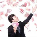 Happy business man hold China money — Stock Photo