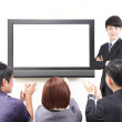 Business man presentation to colleagues with TV — Stock Photo