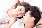 Couple happy smile looking to each other in bed — Stock Photo