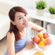 Cheerful woman eat breakfast — Stock Photo