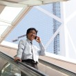 Young business man talking on cell phone — Stockfoto