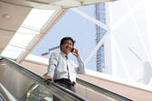 Young business man talking on cell phone — Stock Photo