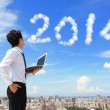Business man look to 2014 cloud — Stock Photo