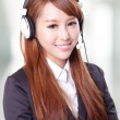 Portrait of happy smiling support phone operator in headset — Stock Photo