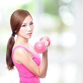 Young sport girl with dumbbells — Stock Photo