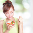 Attractive woman smile eating salad — Stock Photo #38821225