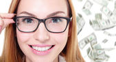 Business woman touch eye glasses with money — Stock Photo