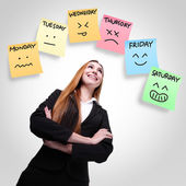 Woman looking stickers with week of face expression — Stock Photo