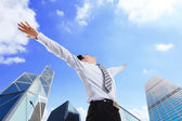 Business man carefree outstretched arms — Stock Photo