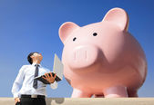Saving Money with my piggy bank — Stock Photo